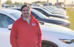 Jonathan Sewell Sells standing in front of Mazda CX-5